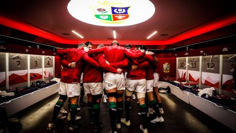 The Lions team huddle before they run out