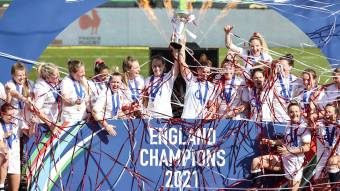 England players celebrate with the trophy